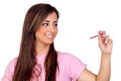 Muchacha de Atractive con un lápiz rojo Fotos de archivo libres de regalías