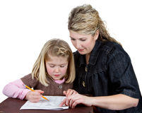 Muchacha de ayuda de la escuela de la mama o del profesor con la preparación Fotografía de archivo