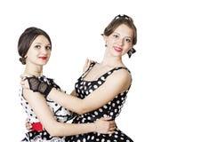 Muchacha de baile en estilo del perno-para arriba en un fondo blanco Imagen de archivo libre de regalías