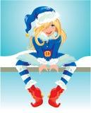 Muchacha de Blondy que lleva el traje azul de Santa Claus Fotografía de archivo