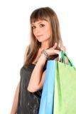 Muchacha de compras aislada en blanco Fotografía de archivo