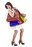 Muchacha de compras con el bolso del grupo. Fotografía de archivo