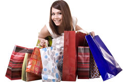 Muchacha de compras con el bolso del grupo. Foto de archivo