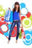 Muchacha de compras sobre fondo abstracto Imagen de archivo libre de regalías