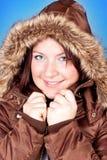 Muchacha de congelación en chaqueta Foto de archivo libre de regalías