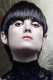 Muchacha de Emo con maquillaje del avantgard Foto de archivo