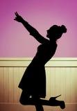 Muchacha de fascinación en la actitud del baile Imagen de archivo
