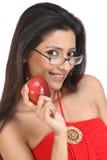 Muchacha de Indan con la manzana y espec. Imagen de archivo libre de regalías