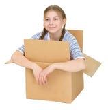 Muchacha de Kawaii en la caja de cartón Foto de archivo libre de regalías