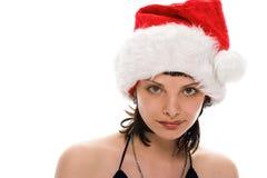 Muchacha de la belleza en casquillo del rojo de santa Fotografía de archivo libre de regalías