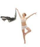 Muchacha de la belleza en danza con el paño del vuelo aislado Foto de archivo libre de regalías