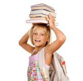Muchacha de la escuela con los libros Imagen de archivo libre de regalías