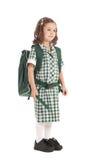 Muchacha de la escuela en uniforme con el morral Foto de archivo libre de regalías