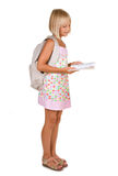 Muchacha de la escuela que lee el libro Imagenes de archivo
