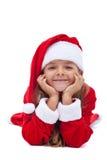 Muchacha de la feliz Navidad que apoya su cabeza Imagenes de archivo