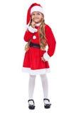 Muchacha de la feliz Navidad que piensa en sus presentes Fotos de archivo