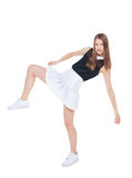 Muchacha de la moda de los jóvenes en la presentación blanca de la falda aislada Imagen de archivo libre de regalías