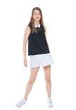 Muchacha de la moda de los jóvenes en la presentación blanca de la falda aislada Fotos de archivo