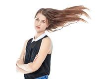 Muchacha de la moda de los jóvenes en vaqueros con el pelo que agita aislado Imagenes de archivo