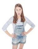 Muchacha de la moda de los jóvenes que muestra la lengua aislada Visión superior Imágenes de archivo libres de regalías
