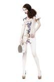 Encanto. Mujer delgada esbelta agraciada en vestido y bolso de moda. Tiempo de primavera imágenes de archivo libres de regalías