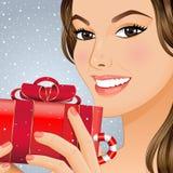 Muchacha de la Navidad con el rectángulo de regalo imagenes de archivo