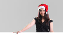 Muchacha de la Navidad con el tablero blanco Imagenes de archivo