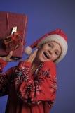Muchacha de la Navidad con los regalos Imagenes de archivo