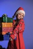 Muchacha de la Navidad con los regalos Imagen de archivo libre de regalías