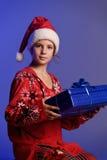 Muchacha de la Navidad con los regalos Imagen de archivo