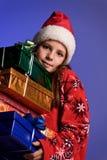 Muchacha de la Navidad con los regalos Fotos de archivo libres de regalías