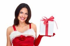 Muchacha de la Navidad del ayudante de Papá Noel con un presente. Fotografía de archivo