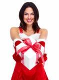 Muchacha de la Navidad del ayudante de Papá Noel con un presente. Imágenes de archivo libres de regalías