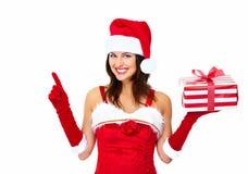 Muchacha de la Navidad del ayudante de Papá Noel con un presente. Fotos de archivo libres de regalías