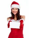 Muchacha de la Navidad del ayudante de Papá Noel con una tarjeta Imagen de archivo libre de regalías