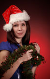 Muchacha de la Navidad en el sombrero de santa Imagen de archivo libre de regalías