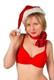 Muchacha de la Navidad en el sombrero rojo de santa Fotos de archivo