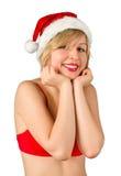 Muchacha de la Navidad en el sombrero rojo de santa Fotografía de archivo libre de regalías