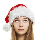Muchacha de la Navidad, mujer joven en el sombrero de santa Imagen de archivo libre de regalías