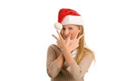Muchacha de la Navidad que indica la muestra de la victoria Imagenes de archivo