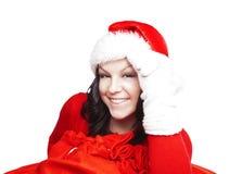 Muchacha de la Navidad que lleva a cabo el presente aislado sobre blanco fotos de archivo