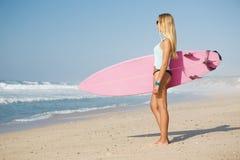 Muchacha de la persona que practica surf Imágenes de archivo libres de regalías