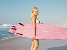 Muchacha de la persona que practica surf de Blode Fotografía de archivo