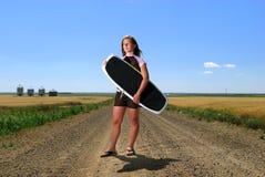 Muchacha de la persona que practica surf de la pradera Foto de archivo libre de regalías