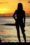 Muchacha de la puesta del sol Imágenes de archivo libres de regalías