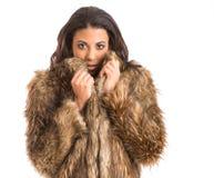Muchacha de la raza mixta en abrigo de pieles Imagen de archivo libre de regalías