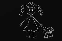 Muchacha de la tiza con el perro Foto de archivo