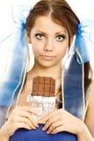 Muchacha de las coletas con el chocolate Foto de archivo