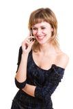 Muchacha de Laughting con un teléfono móvil imagenes de archivo