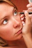 Muchacha de maquillaje Fotografía de archivo libre de regalías